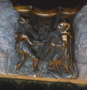 Saint and demon contending- choir stall - Toledo